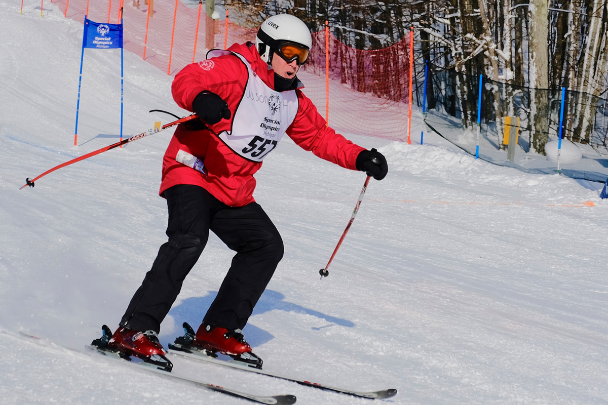 A Special Olympics Michigan athlete skis during the State Winter Games.