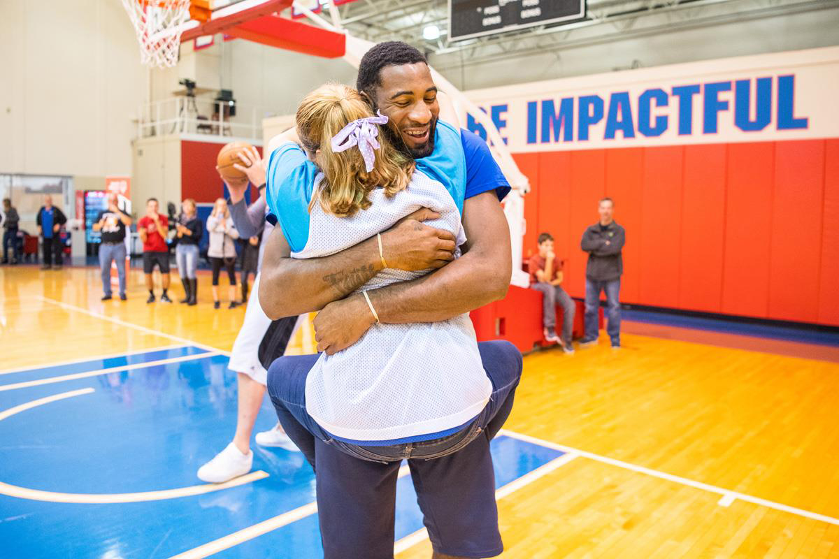 Andre Drummond hugs a SOMI athlete.