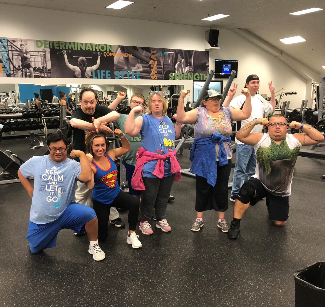 Athletes flex their muscles during a SOMIfit class