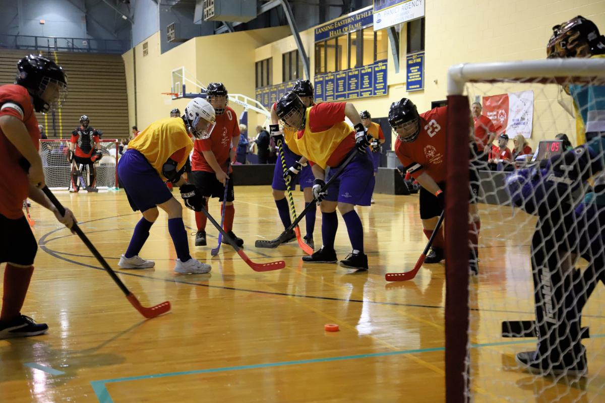 Athletes compete in Poly Hockey at the State Finals.