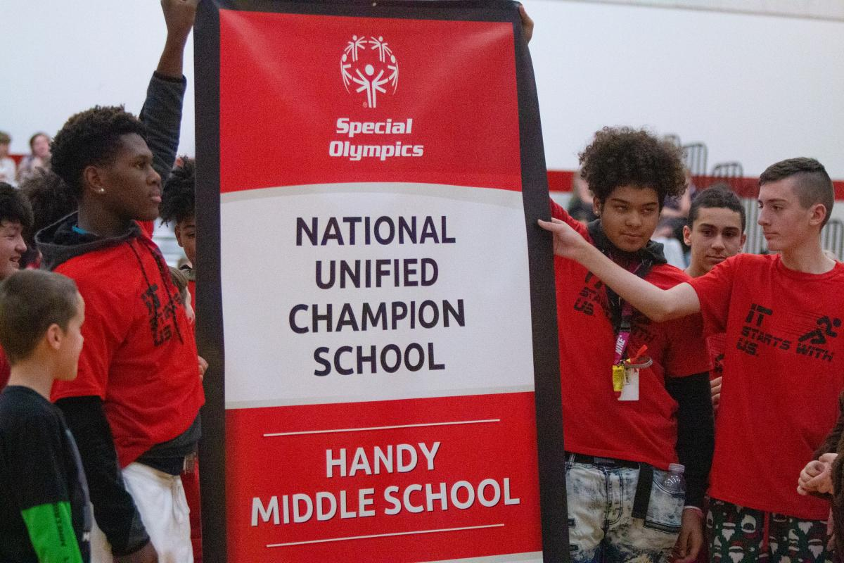 Students at Handy Middle School raise the school's National Banner