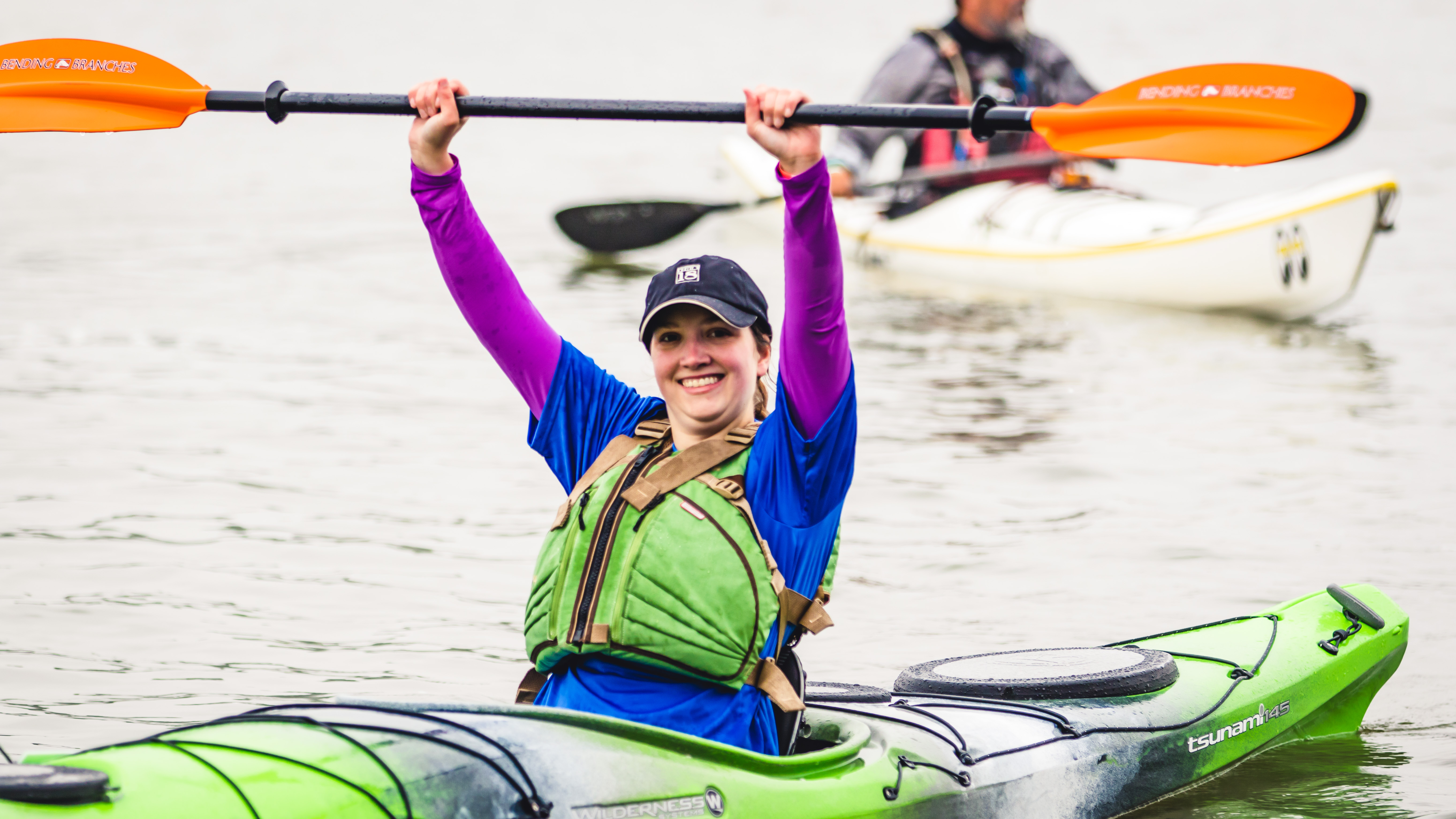 kayaker celebrating