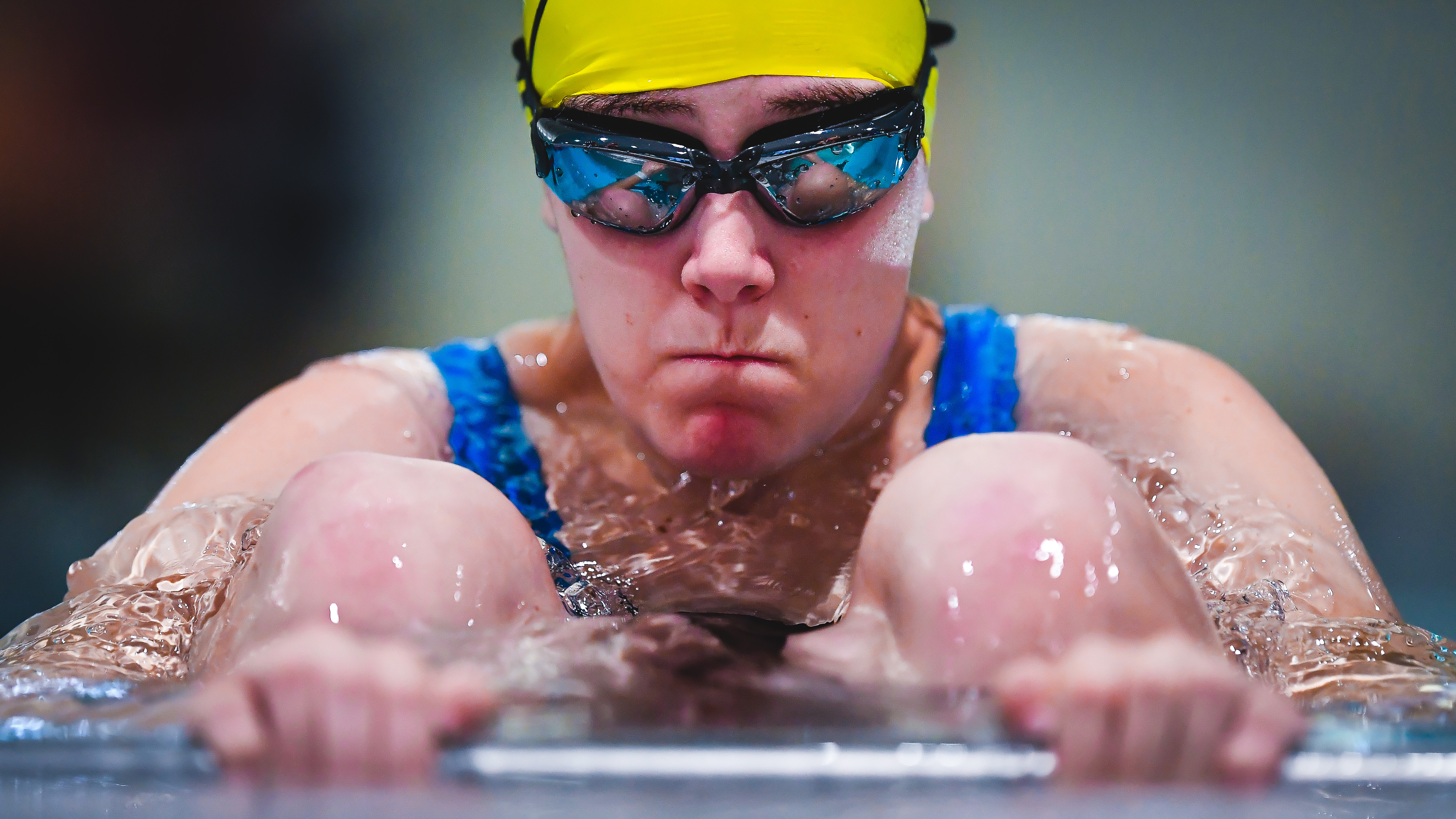 athlete ready to start race in pool