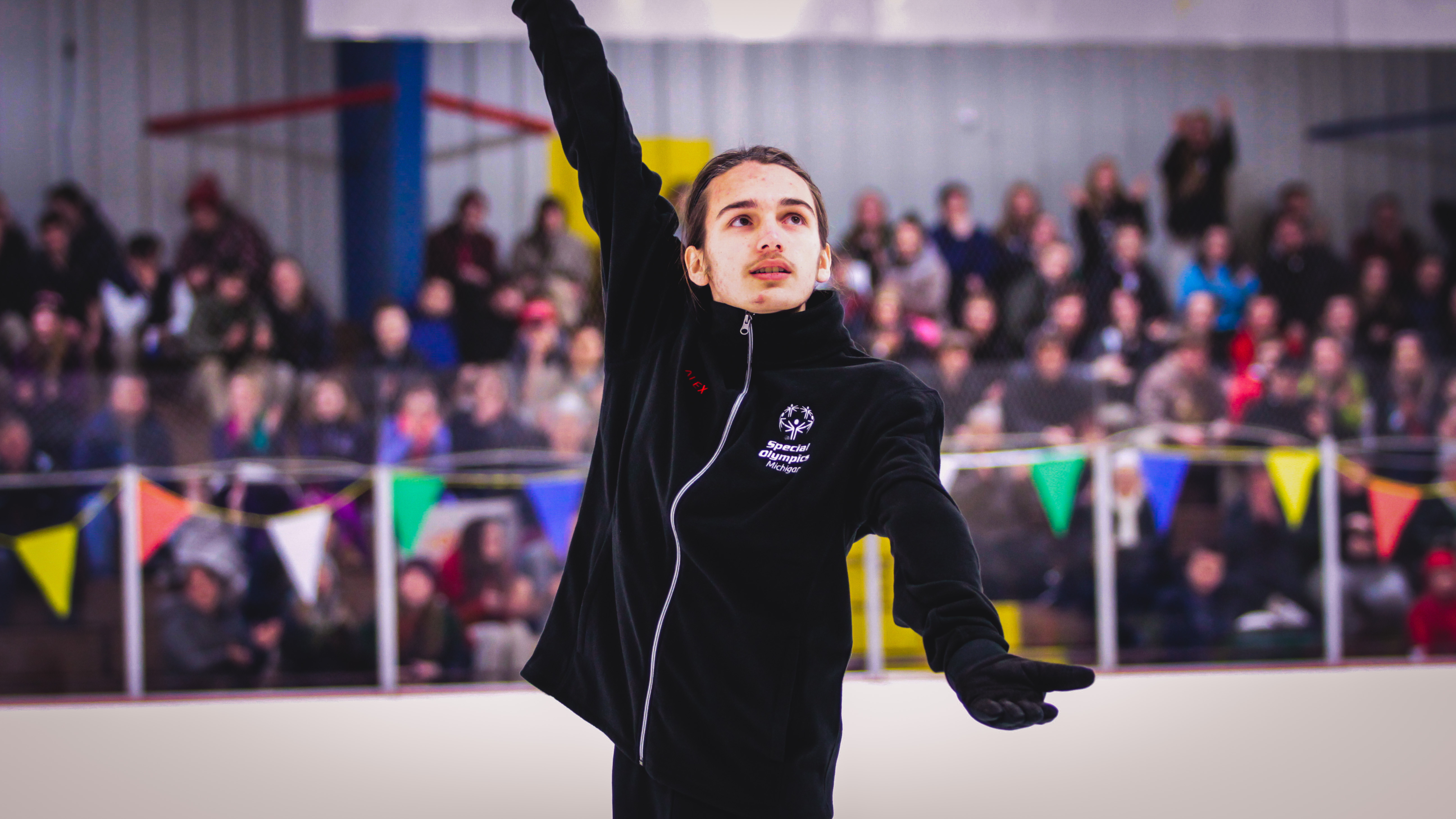 athlete finishing their routine on the ice