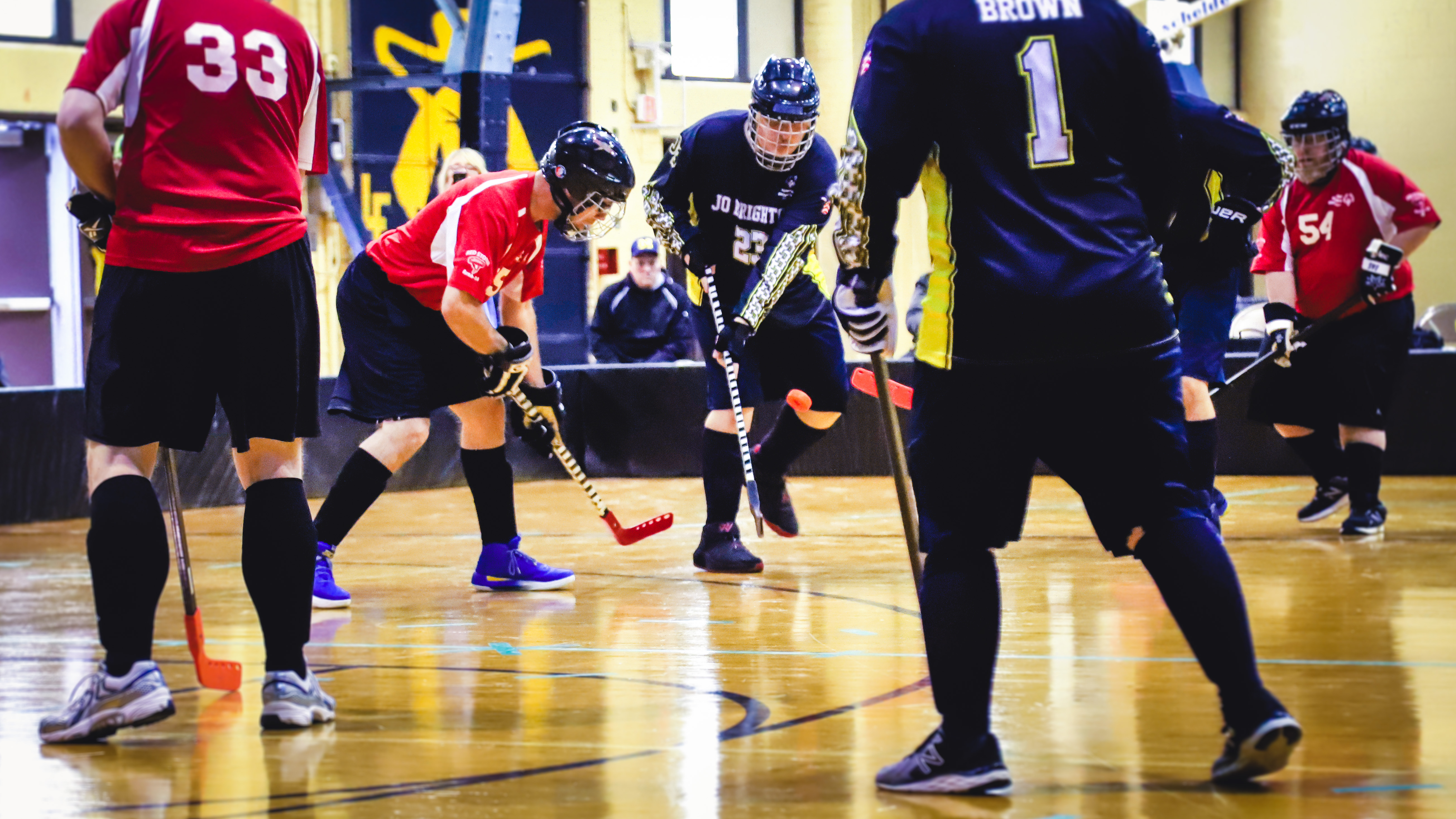 athletes on the court playing poly hockey
